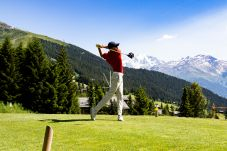 Golf with a view of the Grand Combin massif